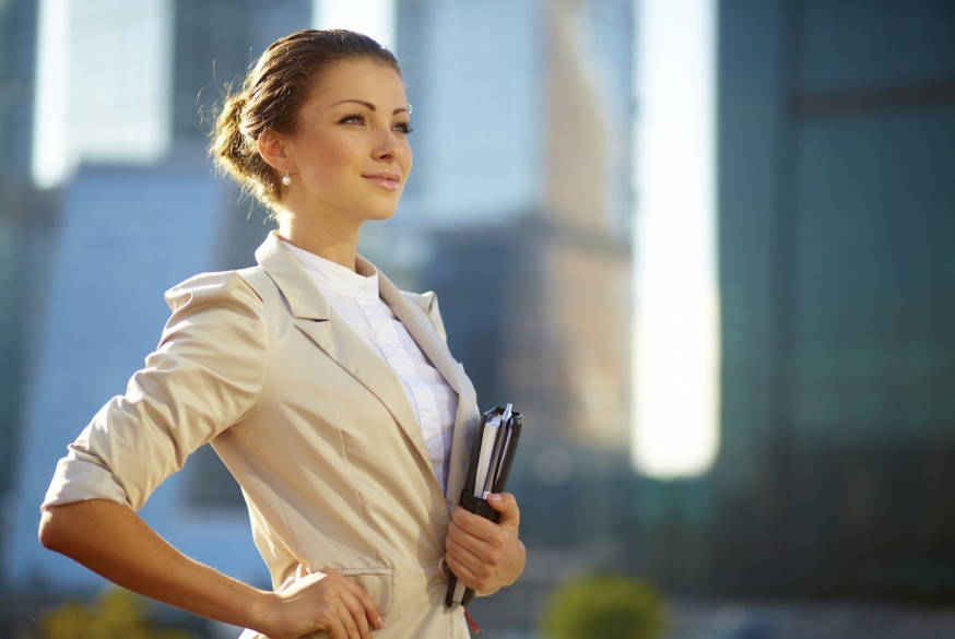 portrait-of-cute-young-business-woman-outdoor-over-building-background.jpg